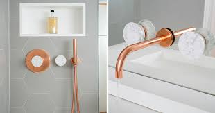copper bathroom fixtures. This Bathroom Features Copper And Marble Fixtures Next To Light Gray Hexagon Tiles S