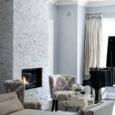 white stacked stone fireplace blue and gray living room grey and white stacked stone fireplace white