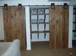 Great Unpainted Closet Barn Doors For Homes With Sliding Style Added Wall  Mouted Shelf As Organizing Appliances Storage As Well As Fake Wood Floors  Ideas