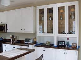 contemporary antique kitchen hutch featuring double glass front graded cabinets with stoned countertops