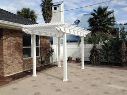 traditional white vinyl pergola kit with square posts on paver patio
