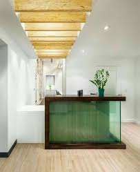 i like the use of wood beams on ceiling idea for front office and nurse station on the side hotels decoration