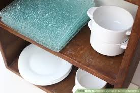 image titled arrange dishes in kitchen cabinets step 7