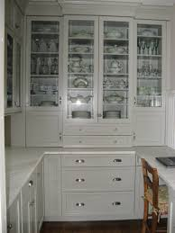 white wooden pantry cabinet with transpa glass door and white