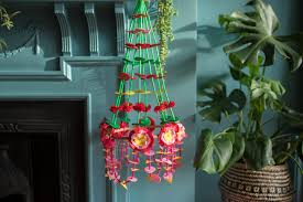 this is a pajaki ounced pie yunky a polish paper chandelier traditionally they are hung in polish houses during winter to represent colourful