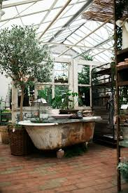 Cute greenhouse that get's a nice dreamy vintage/shabby chic touch through  the old bathtub