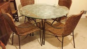 round glass top dining table with 4 wicker chairs
