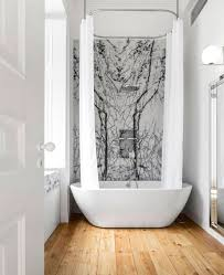 simple stunning bathroom with ceiling to floor shower curtain free standing bath tub wall
