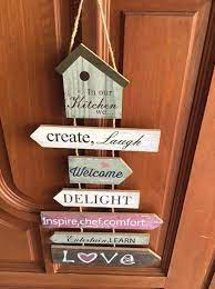 multiple hanging wall plaques signs