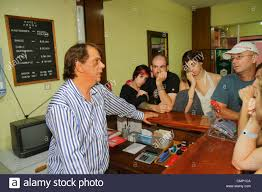 chile arica hotel amaru hispanic budget hotel hospitality front desk clerk job man woman couple check