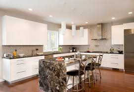 chic contemporary kitchen gray and white mosaic backsplash is cylinder pendant lighting with slab door and