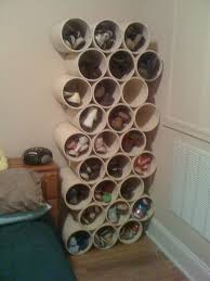 19. Stack PVC Pipe/Paint Cans as Shoe Storage