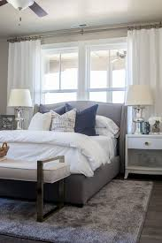 bedrooms with white furniture. Guestroom Inspiration Alice Lane Home Collection | Daybreak Lake Loft Gray Upholstered Bed In Master Bedroom, White Bedding And Neutral Decor Lindsay Bedrooms With Furniture F