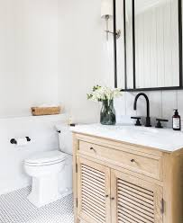 Does A Bathroom Light Need An Earth Light Wood Vanity And Black Accents In A Bathroom Classic