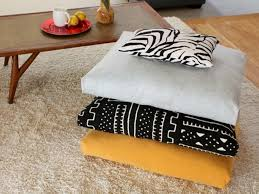 vintage floor cushions ikea with gray and black pattern yellow colors on cream rug plus wood coffee table