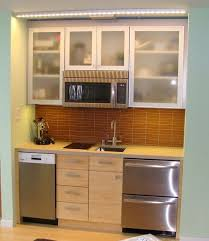 functional mini kitchens small space kitchen unit: mini kitchen smart idea to put the microwave up and cupboards around id probably skip the dishwasher in favor of more cabinets amp use a mini fridge