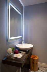lighted vanity mirror in Powder Room Contemporary with Master Bath