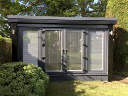 building a garden office. garden office with anthracite windows and black corners fascia building a