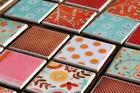 Make your own coasters with tiles, scrapbook paper, clear spray paint, felt  pads, and mod podge. Adhere to tile with Mod Podge and let dry.