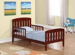 simple kids bedroom. kids bedroom. simple brown wooden bed headboard with blue pillow and blankets feature nice bedroom s