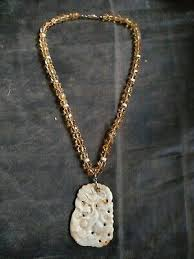 hand carved necklace pendant