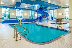indoor pool and hot tub with a slide.  Indoor Microtel Inn U0026 Suites By Wyndham Red Deer Indoor Pool Hot Tub And Slide With Pool And A A