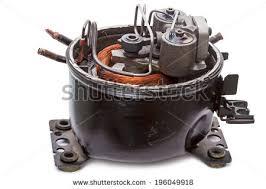 refrigerator compressor. repair refrigerator compressor motor. isolated on white background t