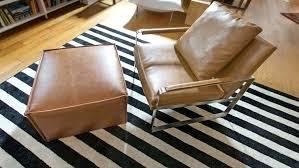 black floor rugs leather chair on black white striped area rug black floor rugs australia black