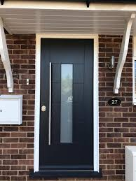 white front door with glass. Anthracite Grey Front Door With Frosted Glass Panel And White Frames. Long Bar Handle In Brushed Chrome For An Ultra Modern Look. F