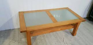 large wooden glass top coffee table with 2 drawers