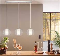 if you are looking for something sweet simple and bright to illuminate your island take a look at this charmer three frosted glass cylindrical shades