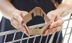 the cup holder is designed with two clippings that attach it to the cart with two additional incisions on the inside of the cardboard that can be adjusted