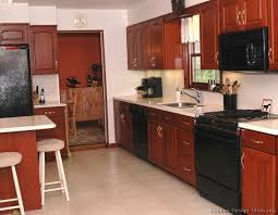 white kitchen cupboards with black countertops lovely mix of black appliances and cherry wood home ideas
