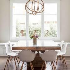 square dining table with rope chandelier