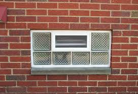 diamond pattern glass block window with an air vent for ventilation innovate building solutions