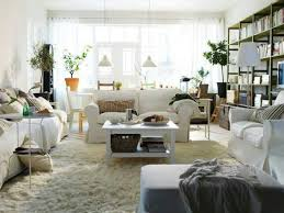 rug under coffee table. living rooms rugs using white faux fur area rug under traditional sofa slipcover beside black reading coffee table