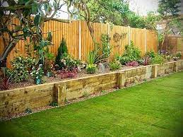 raised flower bed along fence garden