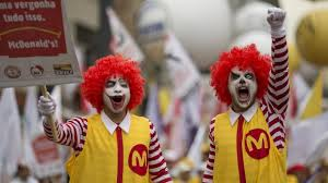 mcdonald s pay deal dirty little secret of the penalty rates  two demonstrators dressed as ronald mcdonald protest for better wages for mcdonald s employees in sao paulo photo andre penner