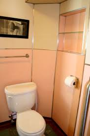 Noelle's 1930s bathroom with pink panel walls - Retro Renovation
