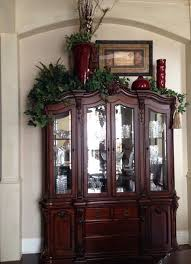 China cabinet decoration -- I would use different colors, but I like the  varied heights. Add lights to the greens?
