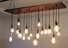 Reclaimed Walnut Barn Wood Chandelier with varying Edison bulbs. $1,045.00,  via Etsy.