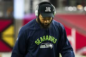 "black like me it s time for a deeper conversation about race in  seahawks defensive end michael bennett wearing a ""black lives matter"" hat before a"
