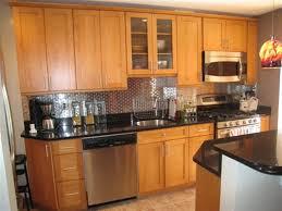 honey oak kitchen cabinets with black granite countertops cabinet