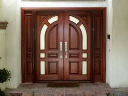 double doors are back in fashion this wooden glass finish double door has a distinct traditional and elegant nature to itself perfect indian door design