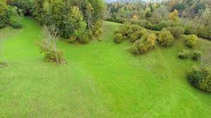 grass field aerial. Perfect Aerial Aerial Shoot Of Grass Field And Senior Couple A Nature  Couple Sitting On Bench In The Middle Nowhere  Stock  Inside Grass Field U