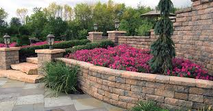 retaining walls were originally built for pure practicality their success as a hardscape feature measured by their effectiveness in smoothing out slopes