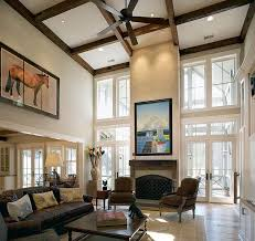 decorating idea for living rooms with high ceilings. Unique Decorating Ceiling Beams And Wall Art Combine To Give The Living Room A Stunning  Ambiance And Decorating Idea For Living Rooms With High Ceilings