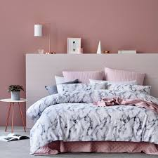 blush pink bedroom with marble and silk sheets