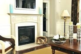 mounting a over fireplace wood and marble work together flawlessly in this incredible flat screen tv