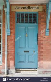 victorian paneled blue painted front door with fanlight and porch of brick built house in llandrindod wells powys mid wales uk